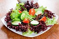 Healthy fresh salad setting on table.
