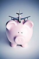 Piggy bank with toy airplane