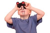 Portrait of a little boy looking through binoculars on white background