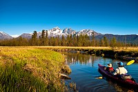 Father and son kayaking on Rabbit Slough in Palmer Haystack Flats Wildlife Refuge on a sunny spring day in the Matanuska_Susitna Valley, Southcentral ...