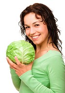 Beautiful young girl with green cabbage, isolated over white