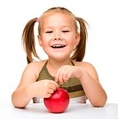 Portrait of a cute little girl with red apple, isolated over white