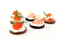 Pumpernickel bread with cream cheese, salmon, caviar and shrimp