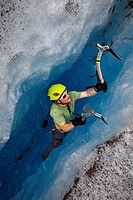 Ice climber ascends a crevasse on Mendenhall Glacier near Juneau, Southeast Alaska, Summer