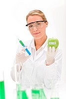 Genetic engineering _ scientist in laboratory, GMO testing experiment