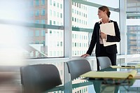 Businesswoman admiring view from office window