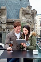 Young couple with digital tablet, digital tablet, Urban terrace bar, Alhondiga building, leisure and culture center, Bilbao, Bizkaia, Basque Country, ...