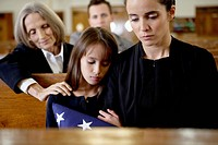 Mother and daughter at military funeral