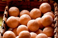 Close up of brown home made soap balls in a wicker basket