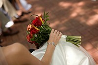 horizontal photograph of a bride holding her bouquet