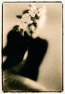 Young female model, flowers in hair, soft focus, lith print, fine art, toned B&W