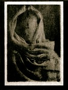 Faceless vintage mannequin wrapped in shawl, paper negative, lith print, fine art
