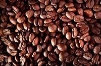Coffee beans close_up, may be used as background