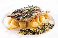 Fresh mackerel fillet with baked potato close up