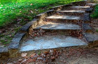 HDR image of curved stone stairs in park garden
