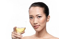 Portrait of beautiful woman with glass white wine