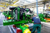 Engine is mounted to a frame in the engine assembly area of the tractor production section at the European headquarters of the American agricultural m...
