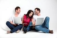 group of carfree friends with laptops