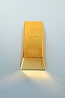 Bullion.Gold bullion on silver shining metal background