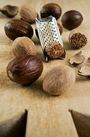 Nutmegs and ground nutmeg with grater.Nutmegs and ground nutmeg with grater Myristica fragrans