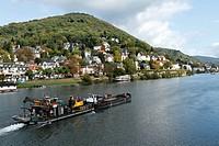 Barge passing villas on the Neckar River, Heidelberg, Baden-Wuerttemberg, Germany, Europe