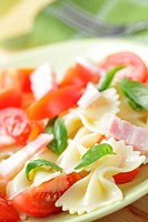 Salad with farfalle pasta, tomato, basil, and bacon