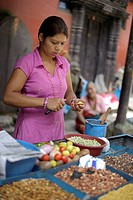 Saleswoman at a spice stand in Kathmandu, Bagmati, Nepal, South Asia, Asia