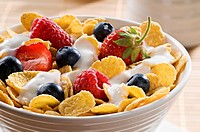 Corn flakes with berries and yogurt close up