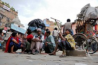 Nepalese sitting in front of rickshaw, Kathmandu, Nepal, Asia