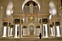 Veiled woman in the prayer hall of the Sheikh Zayed Mosque, Abu Dhabi, United Arab Emirates, Arabian Peninsula, Asia