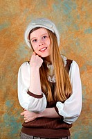 Young blonde teenage girl with white wool hat