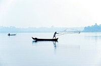 Fishermen standing on a fishing boat casting his net, Burma, Myanmar, Southeast Asia, Asia