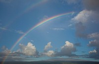 Rainbow over the volcano.Rainbow over the mauna kea volcano , hawaii