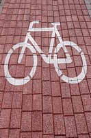 bike sign painted on a brick pavement