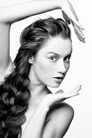 hairstyle portrait of beautiful surprised brunette girl with creative braid hairdo