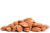 Extreme close_up image of almonds studio isolated on white background