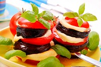 towers of grilled slices of aubergine with tomato and mozzarella