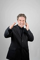 Businessman wearing a black suit talking on a mobile phone