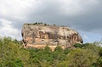 Sigiriya Lion´s rock is a large stone and ancient rock fortress and palace ruin surrounded by the remains of an extensive network of gardens, reservoi...