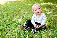 Portrait of little boy on the grass.