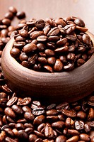 Close_up of coffee beans in a cup. Studio shot.