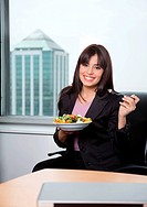Portrait of business woman having fresh salad of vegetables