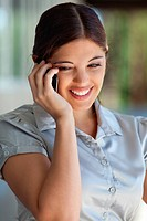 Smiling businesswoman talking on mobile