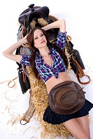 Beautiful Country Cowgirl riding or resting on her saddle