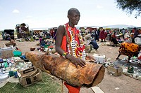 Weekly open air market in South kenya, bordering game park ´Maasai Mara´, inhabited by the massai ethnic tribe The Massai sleep on a cowskin which t...