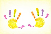 Colorful painted handprints on textured background.