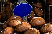 fresh bread on a market with an empty blue sign
