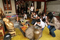 People visiting a temple in La Per Her In Myanmar Burma, thousands of people have settled near the border as a result of oppression in their homeland ...