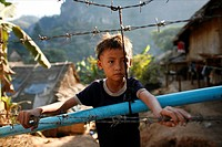 Young refugee boy in Mae Sot Around 130,000 Burmese refugees have settled in Thailand due to opression in their homeland of Myanmar Burma Approximatel...