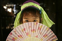 A young Longneck girl hides behind her fan Approximately 300 Burmese refugees in Thailand are members of the indigenous group known as the Longnecks T...